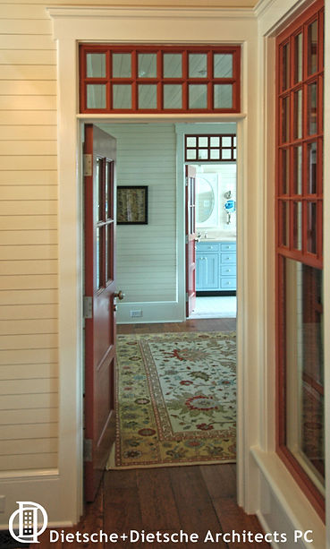 Interior windows and transoms share the dappled light from room to room.