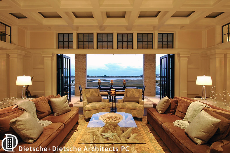 The living room, which opens to an infinity pool and waterfront vista, is featured on TV's Revenge.