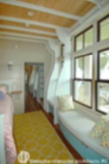. Curved window seats are framed with hull shaped ribs.