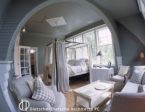 A romantic bedroom suite is trimmed in painted bead board and curving lines.