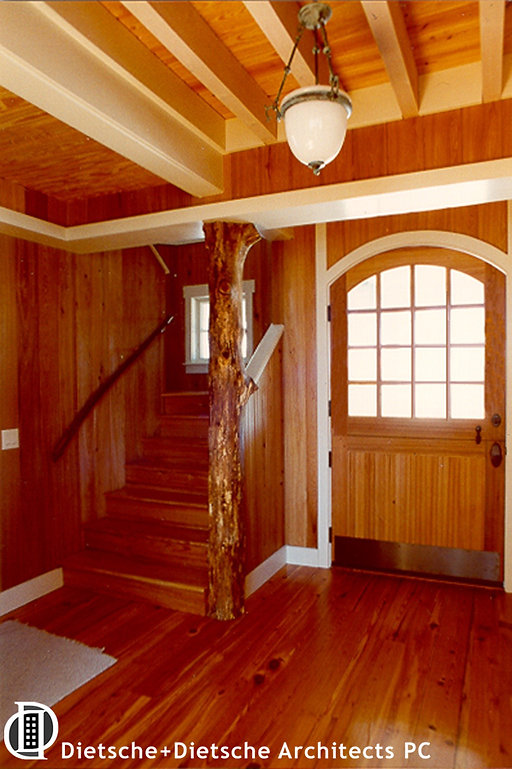 Rustic woods and a tree trunk sculpt this elegant camp style staircase
