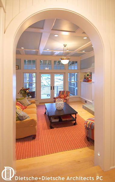 Take two steps down to the living room to find yourself in a cheerful vantage point above the lake.