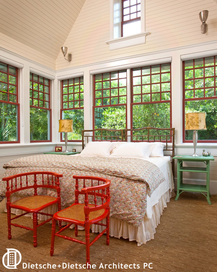 The bedroom at Cottage in the Trees creates a memory of summer nights on a sleeping porch.
