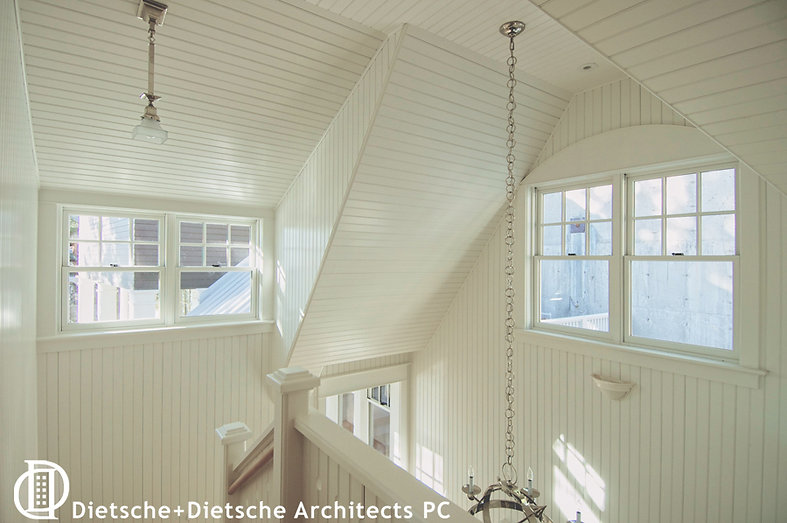 The top of the staircase at Cottage on a Lake opens directly into the children's bedrooms.