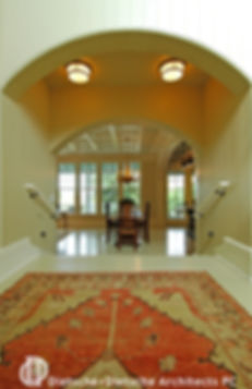 A double arched stair transports guests down into the main room of the cottage.
