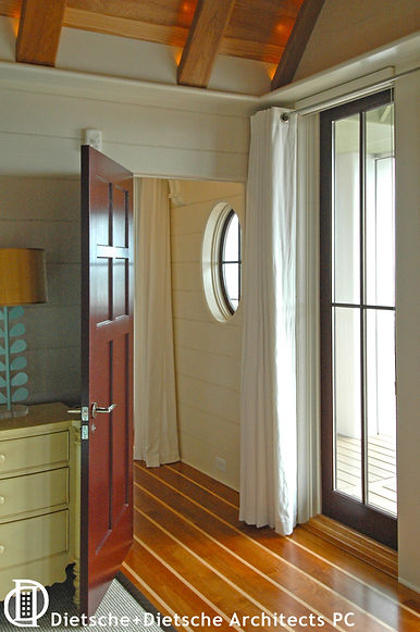 Sailcloth curtains, a deck-planked floor, and a port hole window keep everything ship shape.