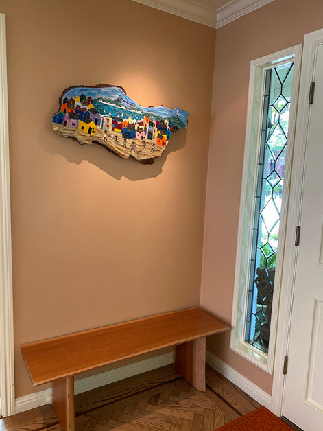 """""""Touring Brazil"""" is hung at the main entrance of the Clients'home."""