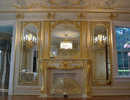 Gilding of interior architectial ornaments in a residential home