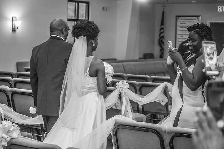Courtney walking down the aisle wit her dad