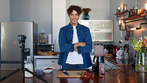 male nutritionist posed in a kitchen