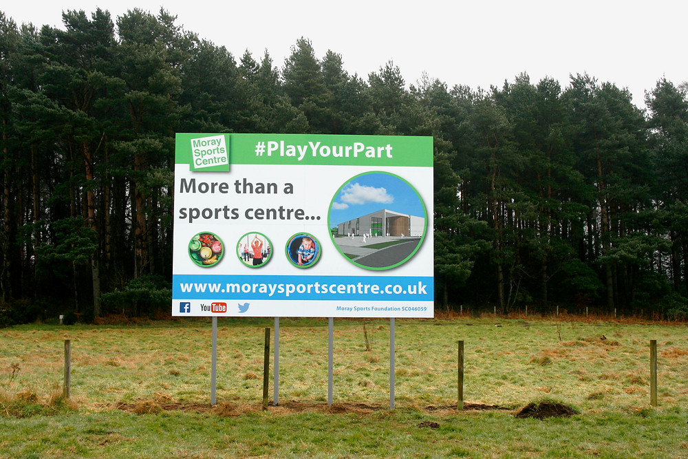 Billboard announcing the build of the Moray Sports Centre