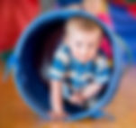 Baby boy in play tunnel