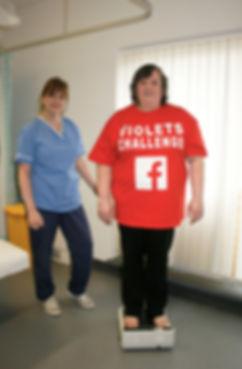 Violet getting weighed by nurse