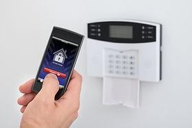 bigstock-Security-Alarm-Keypad-With-Per-80854283.jpg