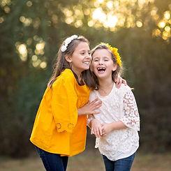 siblings-laughing-fall-family-portraits-christmas-card.jpg