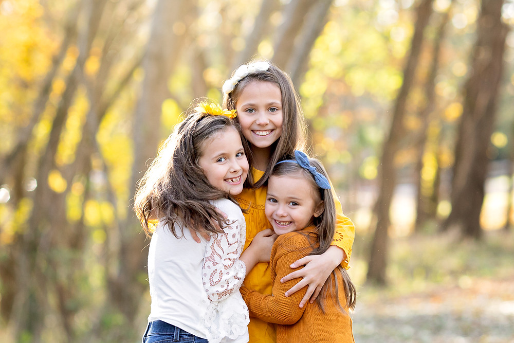 outdoor autumn portrait of three young girls