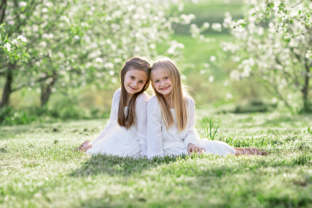 two girls posing in a apple orchard