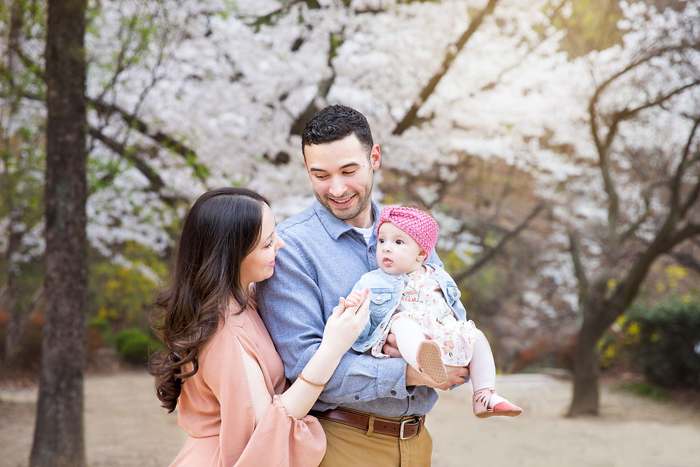 young family portrait outdoor cherry blossoms