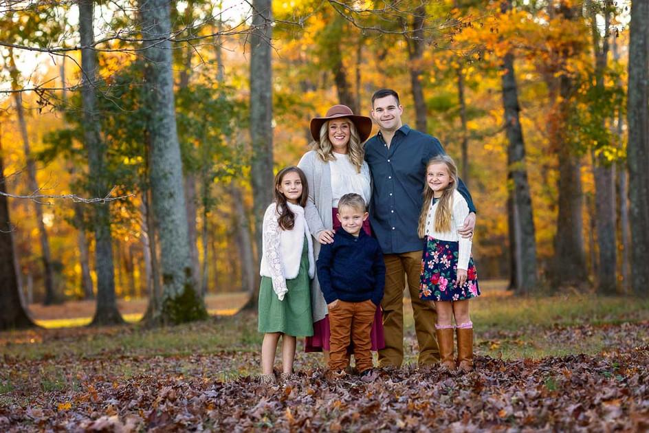 bright-happy-family-portrait-elementary-kids.jpg