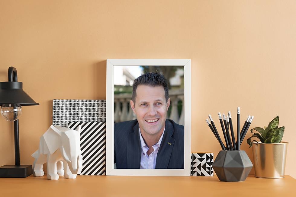 pic in frame on orange desk.png