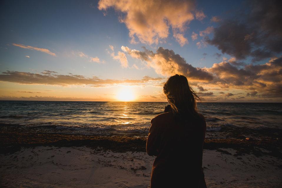 woman-watching-beach-sunrise.jpg