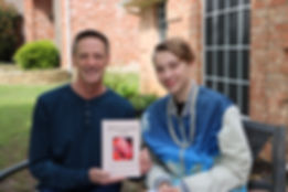 Author Jeff Horacek, first book signing, with son