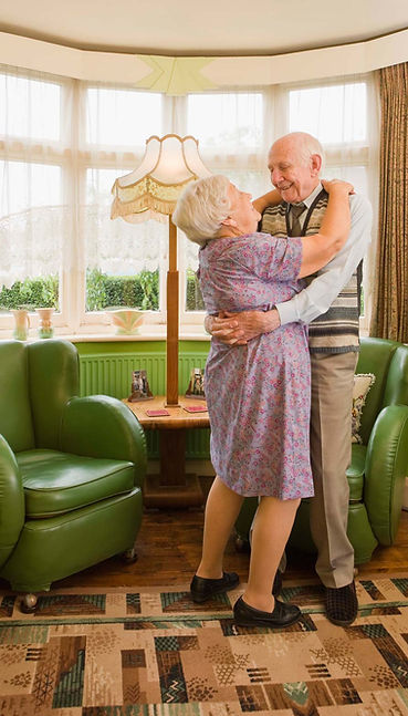 Older Couple Dancng In Their Home