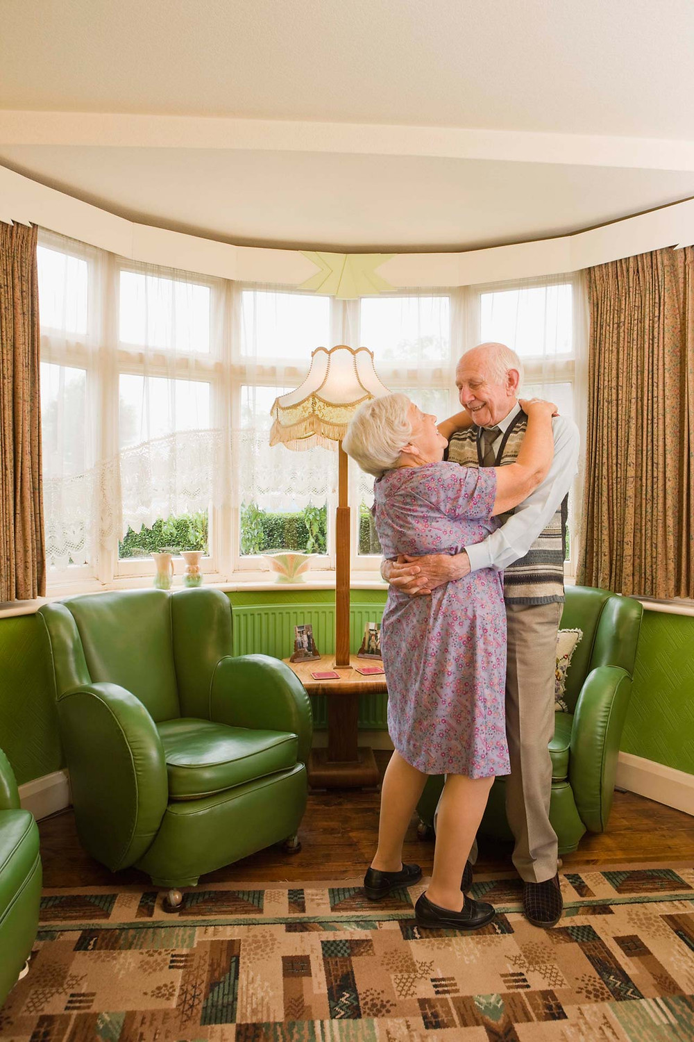 Elderly Couple Dancing in their Living Room