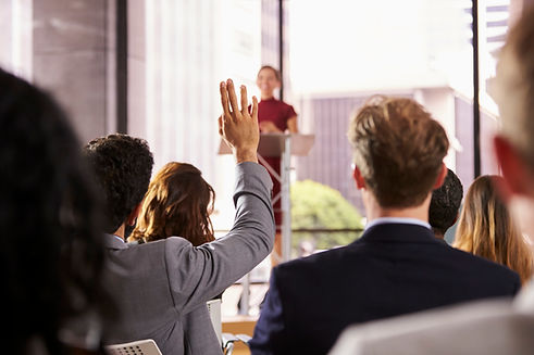 presenter-at-business-seminar-takes-a-qu