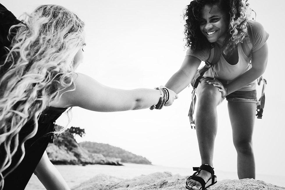 young-women-helping-each-other-5X6VAKC.jpg