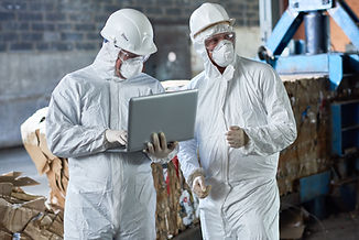 workers-in-hazmat-suits-at-modern-recycl