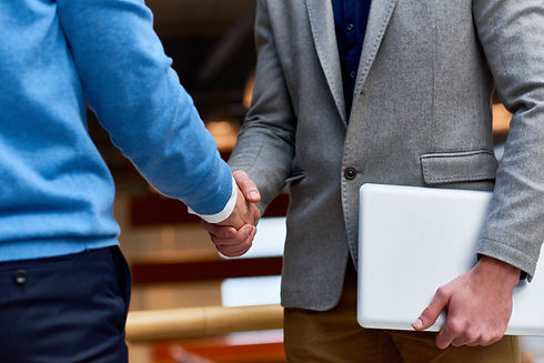 business-people-shaking-hands-indoors-W8