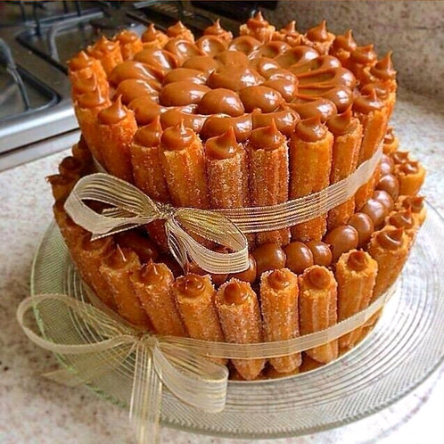 200 PIECES CHURROS CAKE ; ASK FOR FLAVORS $2.00 EACH