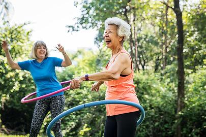 senior-woman-exercising-with-a-hula-hoop