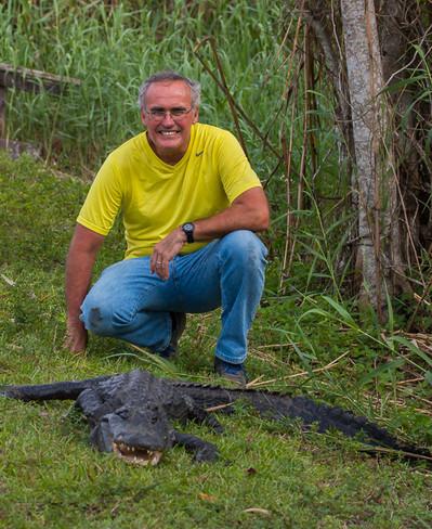 Karl behind an alligator