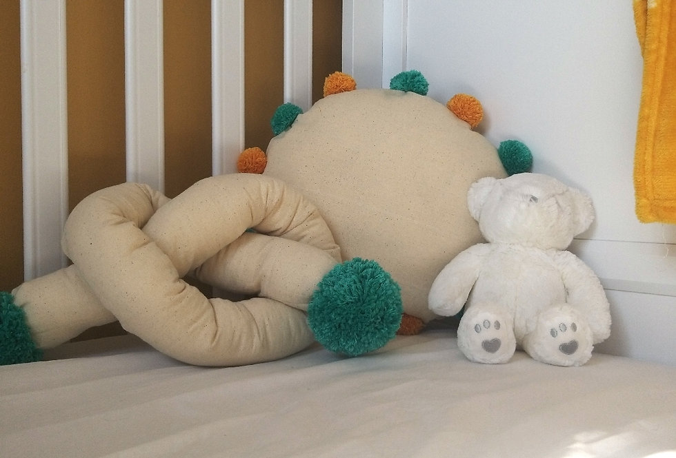 Fifi and me... Sausage cushion with turquoise pompoms