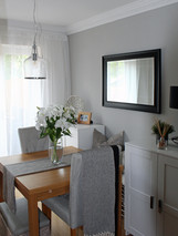 light bright dining room with additional storage for a small space