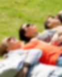 Friends Relaxing on Grass