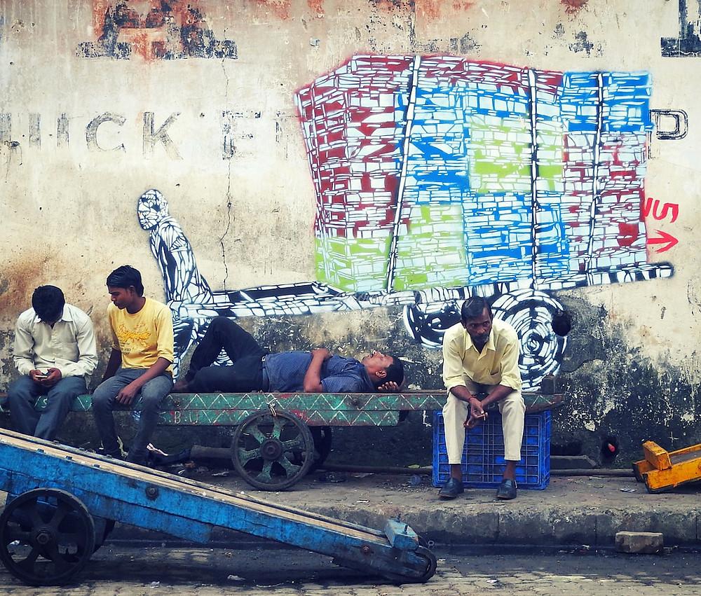 wall mural of wheelbarrow in Mumbai streets