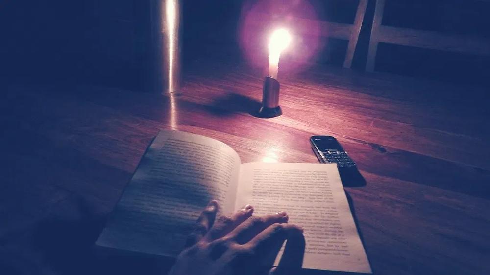 basic mobile phone, nokia phone, candlelight, reading