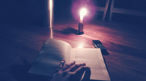 basic mobile phone, nokia phone, candlelight, reading