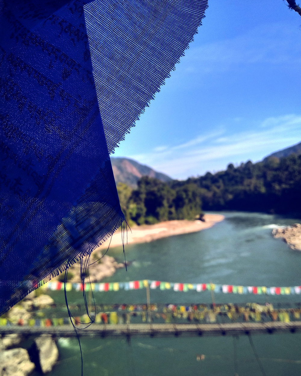 Buddhist prayer flags on a bridge