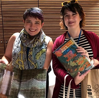 Emily Friedman and Emily Kugler with D&D and TRPG materials