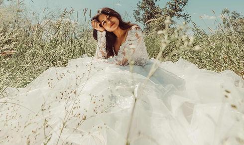 Bride Wearing Essense of Australia Wedding Dress in a field.jpg