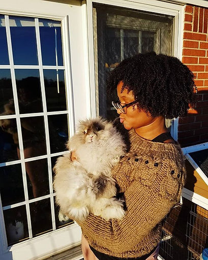 Kissing my angora baby in my #owlsweater