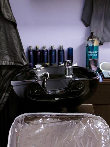 Tilting shampoo bowl