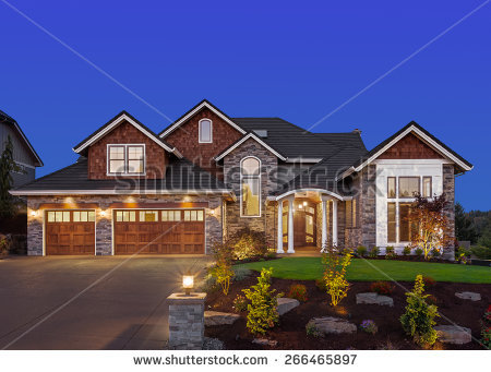 stock-photo-home-exterior-at-night-new-luxury-house-at-night-with-deep-blue-sky-three-car-garage-col