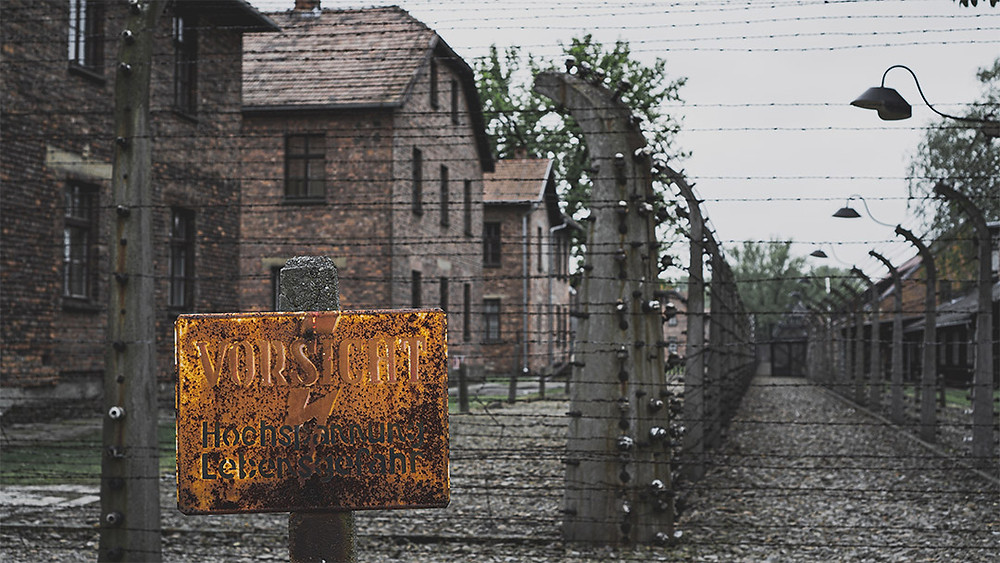 Auschwitz signpost electricution and barbed wire