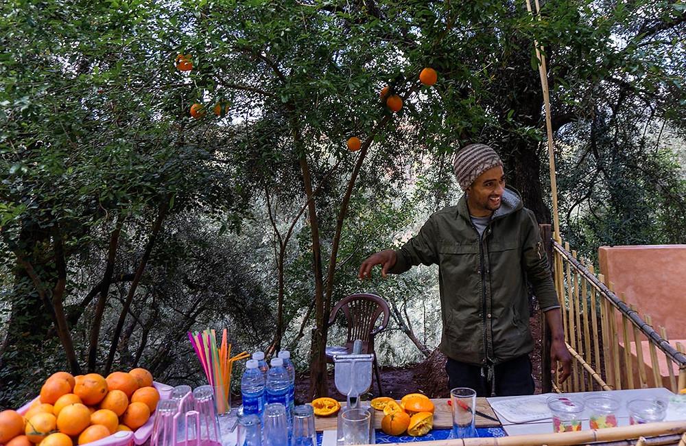 man selling freshly squeezed orange juice