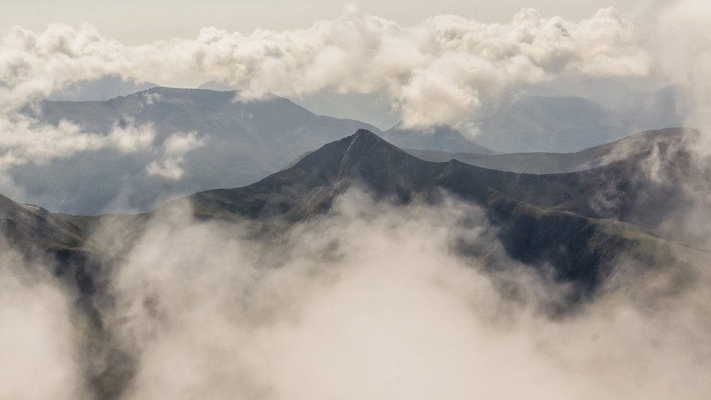 mountains and clouds at high altitude